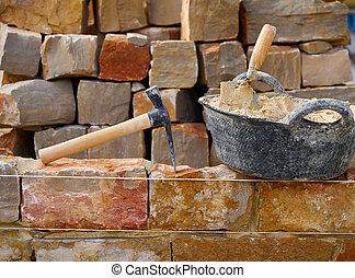 Masonry stone wall construction with tools