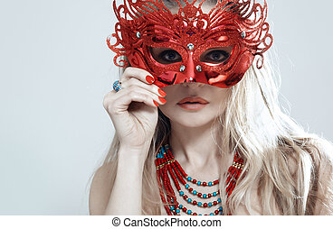 Masquerade - Blond lady in jewelry holding masquerade mask