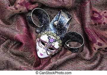 Masquerade carnival mask on the fabric background