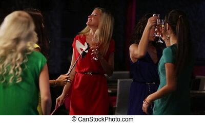 Masquerade - Girls wearing masks having fun at the nightclub...