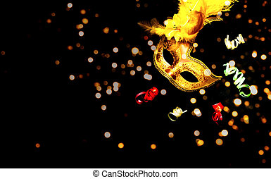 Masquerade mask on black background with sparkles. The concept of traditional holidays. Close-up
