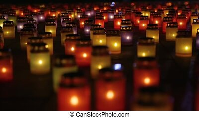 Mass Candle Light Vigil. Symbolism Of Loss and Mourning. Many burning lanterns on memory. Feeling of sadness, pain and suffering. Laterns represent the memories of loved ones. Blurred background.