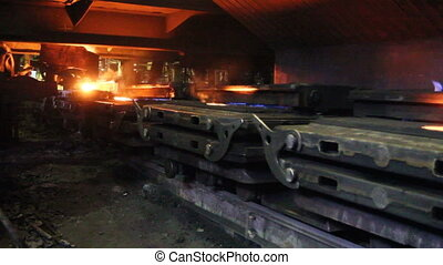 Production line for filling molds with liquid metal at the iron works, molten steel pouring.