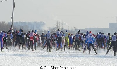 Mass start men athletes skiers during Championship on cross country skiing