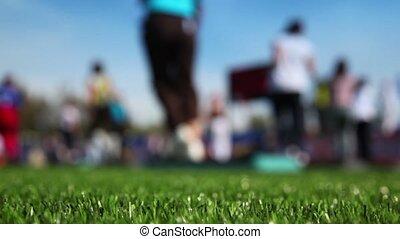 Mass step aerobics exercise at stadium in sunny autumn day,...