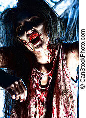 massacre - Bloodthirsty zombi standing at the night cemetery...