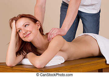 massage #31 - Woman lying on massage table with the hands of...