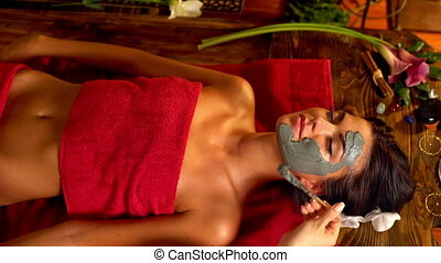 Massage and clay body mask in spa salon.Top view. 4k.