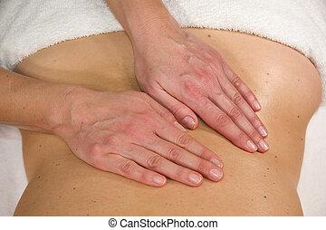 massage at lumbar region - a natural mature woman having a...
