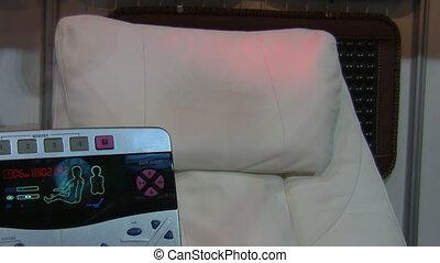 Massage chair control - Close up of a modern robotic massage...