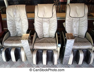 Massage Chairs - Coin operated armchairs that massage your...