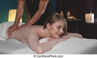 Massage concept. Young attractive woman reciving relaxing massage