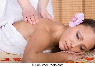massage - happy woman relaxing in spa salon