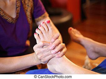 Massage of human foot in spa salon
