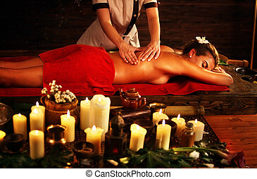 Massage of woman in spa salon. Luxary interior oriental therapy .