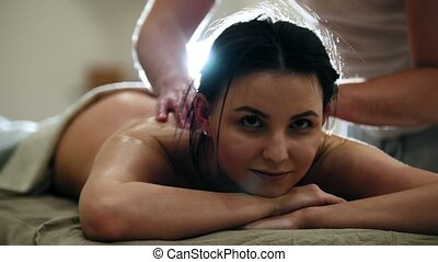 Massage parlor -attractive girl gets relaxing healing...