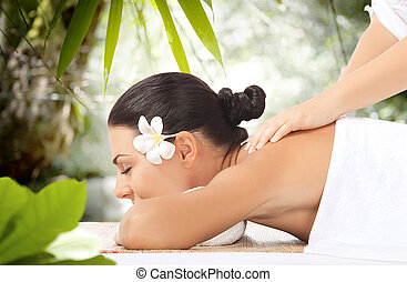 massage - portrait of young beautiful woman in spa ...