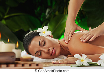 massage - portrait of young beautiful woman in spa...