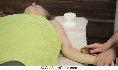 Massage scraper gouache. masseur makes acupressure on a...