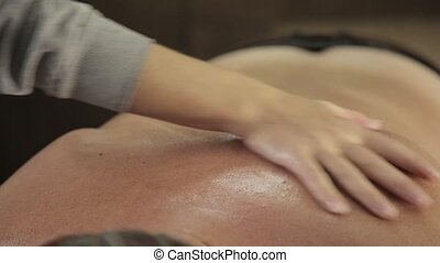 Massage scraper gouache on a male back