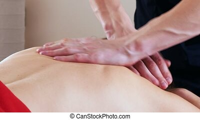 Massage session. Young woman receiving relaxing massage. Back
