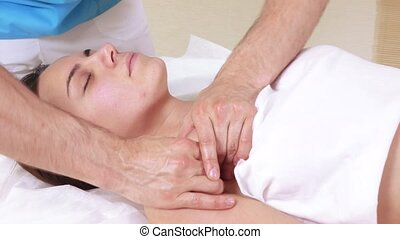 Massage shoulders of girl