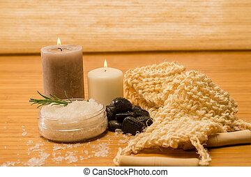 Massage skin care scrub and salt on wooden background