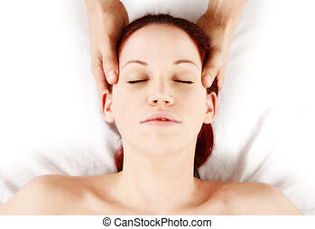 massage - woman getting head and neck massage by therapist