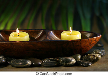 Massage stones and spa candles for wellness concept