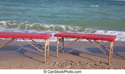 Massage tables on the beach - On the seashore there are...