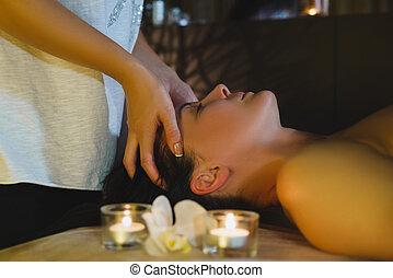 Massage therapist massaging beautiful brunette - Female...