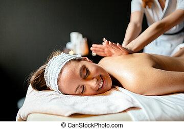 Massage therapist massaging woman - Massage therapist...