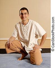 Massage therapist - male massage therapist in pose in...