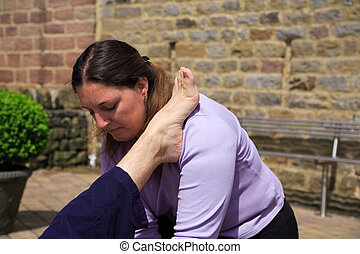 Massage therapist carrying out a Thai body massage