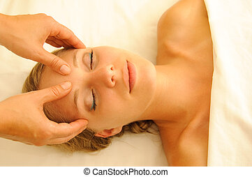 Massage Therapy - Beautiful woman in a spa with massage ...