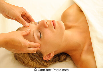Massage Therapy - Beautiful woman in a spa with massage...