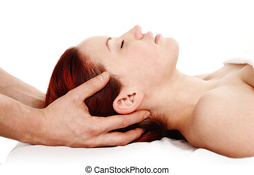 Massage therapy - woman getting a head and shoulder massage...