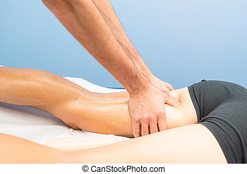 Massage to the thigh of a physiotherapist to an athlete