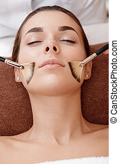 Massage with brushes to a client