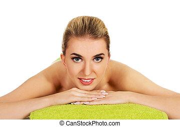 massagem, mulher, tabela., jovem, mentindo