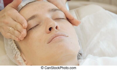 Massaging the face in the beauty salon