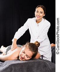 Massagist working in spa center