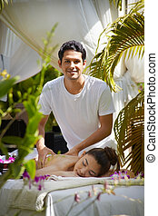 Masseur at work massaging woman in luxury spa - Portrait of...