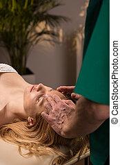 Masseur doing head massage
