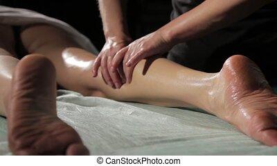 hands of osteopath doing foot massage, foot reflexology treatment