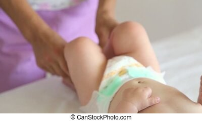Masseur doing massage a small baby.