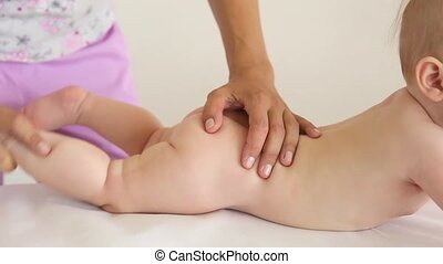 Masseur doing massage a small child.