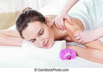 Masseur doing shoulder massage