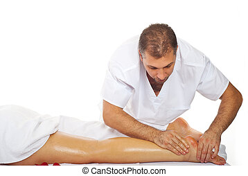 Masseur give therapeutic massage to woman legs