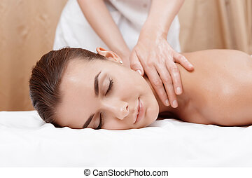 Masseur gives neck and shoulder massage